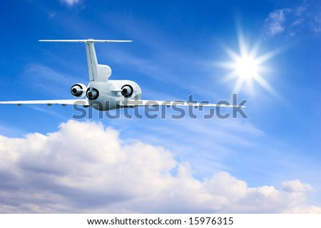 Commercial airliner flying in high sky - stock photo
