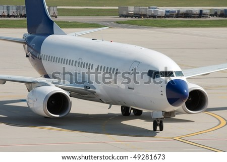 Commercial airliner on the runway - stock photo