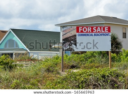 Commercial beachfront property for sale sign at Florida, USA. - stock photo