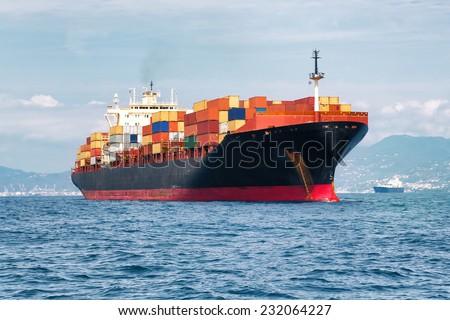 commercial cargo ship full of containers - stock photo