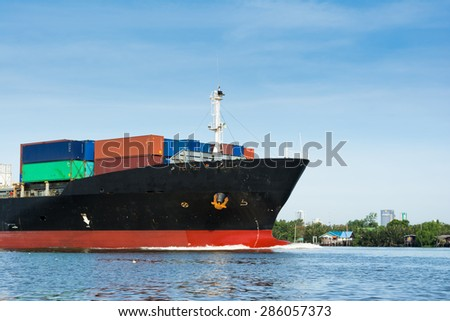 commercial container ship near the coast - stock photo