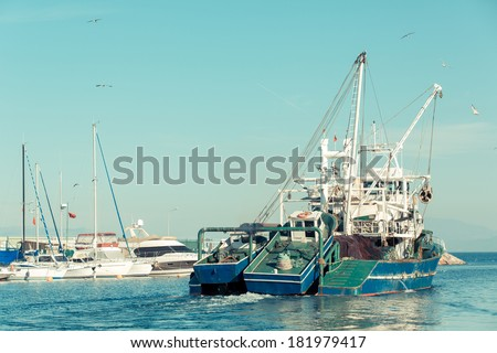 commercial fishing boat leaving harbor at Tirilye (Zeytinbagi) near to Bursa, Turkey  - stock photo