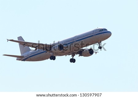Commercial passenger jet on final landing approach - stock photo