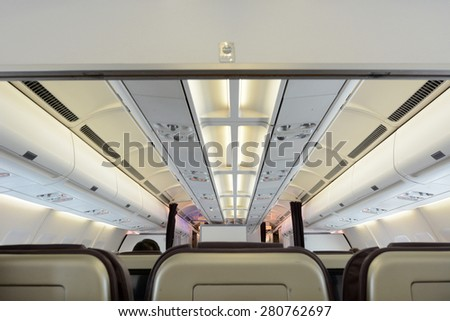 Commercial passengers airplane interior of rows of chairs. concept photo copy space - stock photo