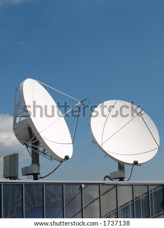 Commercial satellite antennas on a building - stock photo