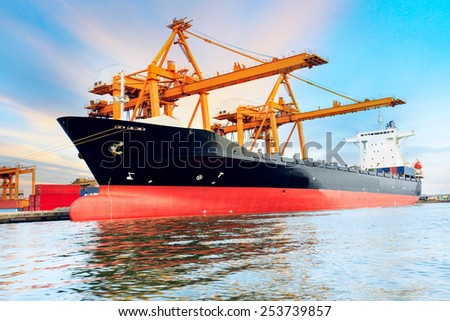 commercial ship loading container in shipping port image use for import ,export nautical vessel transport and industry logistic - stock photo
