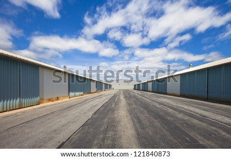 Commercial storage buildings on a blue sunny day - stock photo