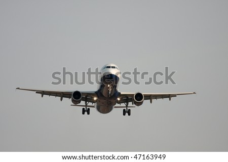Commertial aircraft landing - stock photo