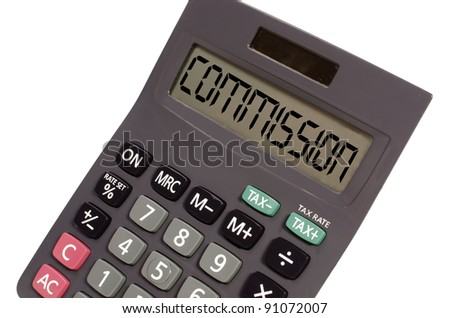 commision written on display of an old calculator on white background in perspective - stock photo