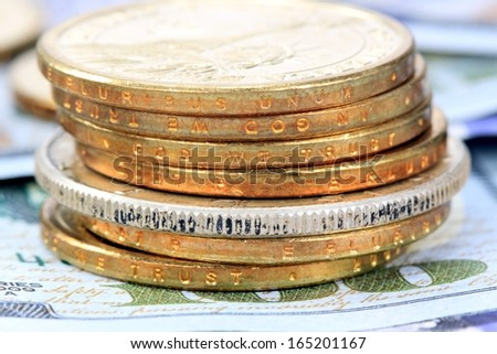 Commodity Trading Concept - Gold and Silver Coins with US Currency - stock photo