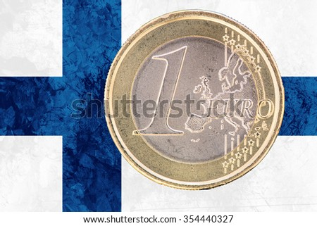 Common face of one euro coin from Finland isolated on the national finnish flag as background - stock photo