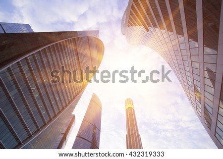 Common modern business skyscrapers, high-rise buildings, architecture raising to the sky, sun. Business building in the evening light. Concepts of financial, economics, future etc. - stock photo