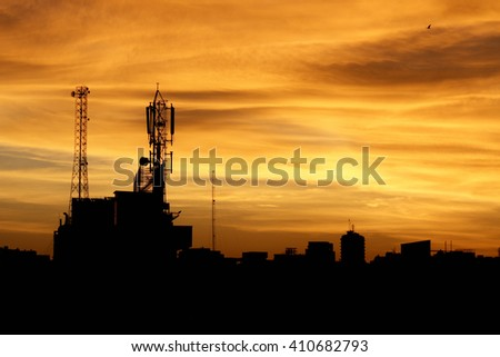 Communication antenna against colorful sky - stock photo