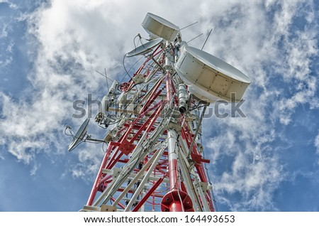 Communication antenna tower is, typically, tall structures designed to support antennas for telecommunications and broadcasting, including television. - stock photo