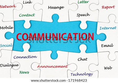 Communication concept words on group of jigsaw puzzle - stock photo