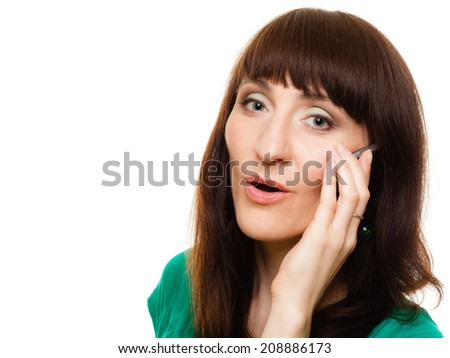 Communication technology. Sad upset girl surprised young woman talking on mobile phone smartphone isolated on white. - stock photo