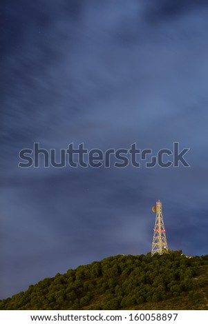 Communication tower at night. Long exposure. Stars in the sky. - stock photo