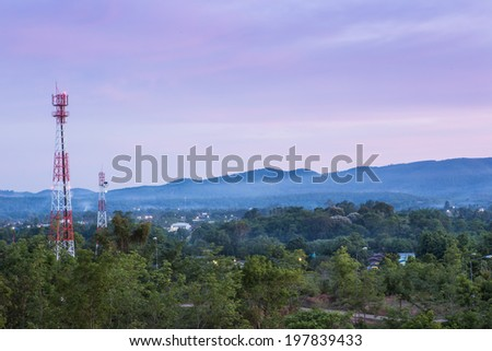 Communication towers in twilight. - stock photo