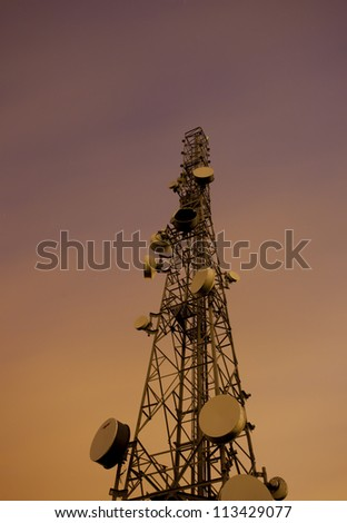 communications tower at night against the night sky - stock photo