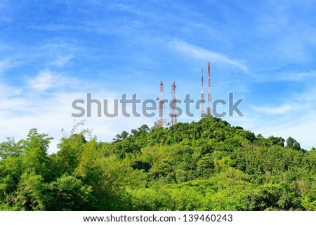 Communications tower with antennas on the mountain - stock photo