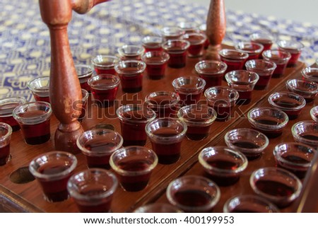 Communion cups filled with wine - stock photo