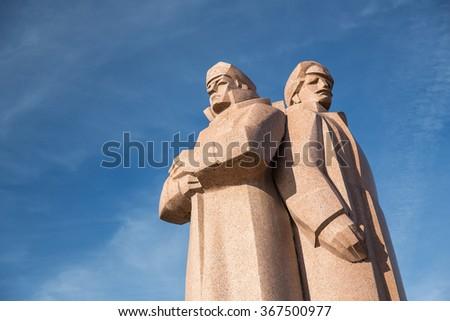 Communist statue in Riga, Latvia. - stock photo