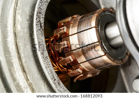 Commutator, a part of the electric motor used to drive the car wipers - stock photo