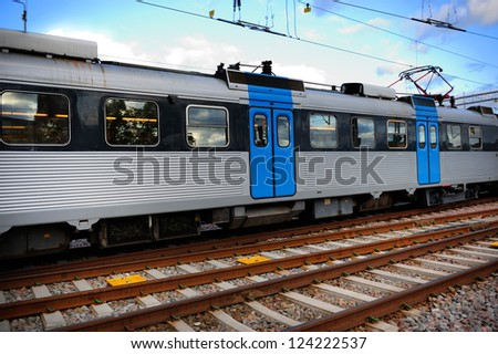 Commuter train and tracks - stock photo
