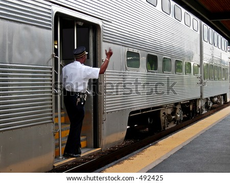 Commuter train conductor - stock photo