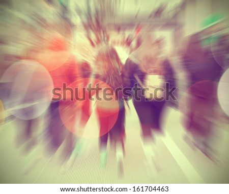 Commuters crossing at rush hour, blur motion.  - stock photo