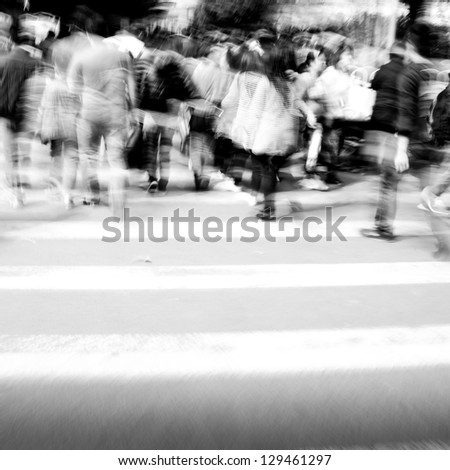 Commuters crossing at rush hour, blur motion, black and white - stock photo