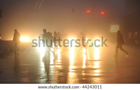 commuters crossing the street  during evening rush hour - stock photo
