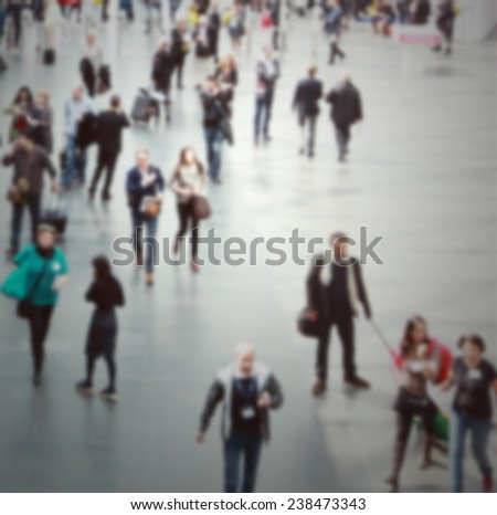 Commuters, intentionally blurred post production. - stock photo