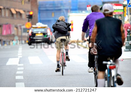 Commuters on bikes - stock photo