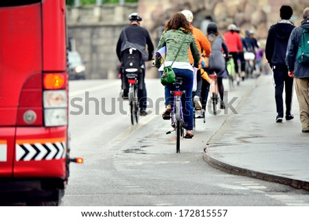 Commuters on their way home on bikes in the rain - stock photo