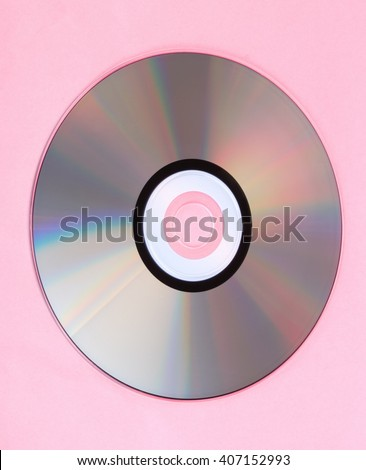 compact disc on pink background - stock photo