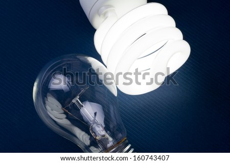 Compact Fluorescent Light bulb and tungsten Light bulb - stock photo