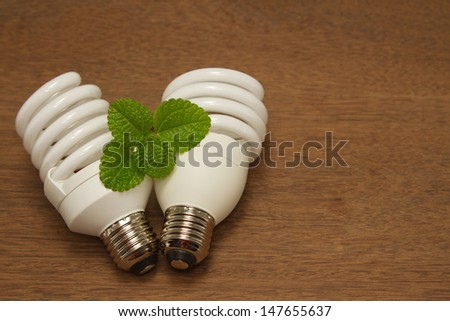 Compact Fluorescent Light Bulb,green concept innovation energy-saving - stock photo