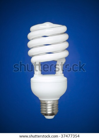 Compact fluorescent light bulb isolated over blue background. - stock photo