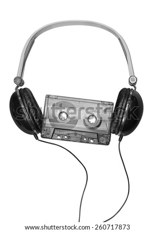 Compact headphones with audio cassette on white background  - stock photo