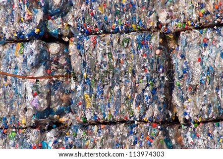 Compacted recyclable plastic waste at a recycling plant. - stock photo