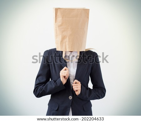 Company employee with paper bag over her head - stock photo