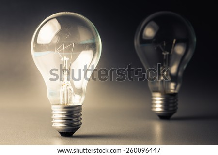 Comparative light bulb - stock photo