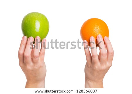 Compare apples with oranges - stock photo