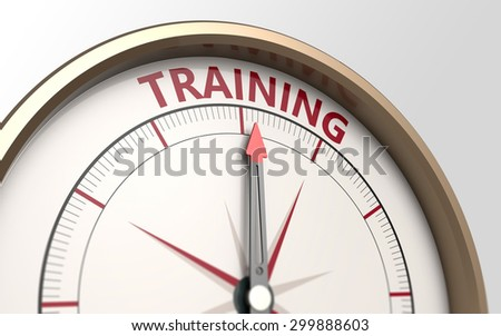 Compass and an arrow pointing to the word training - stock photo