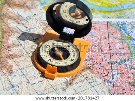 Compass and  maps. Compass on the map - this is the open door to the country adventure. - stock photo