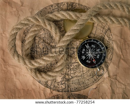 compass and old map as a background - stock photo