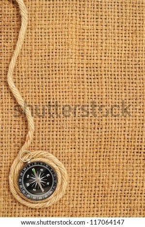 compass and ropes Roll on sack - stock photo