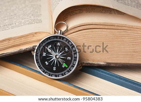 compass and the old books - stock photo