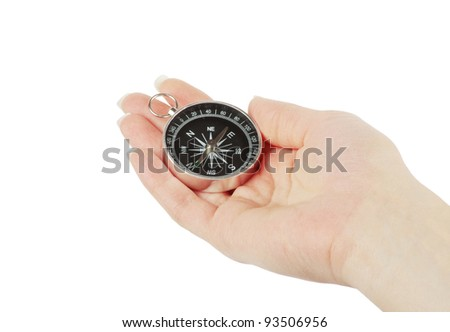 Compass in a hand - stock photo